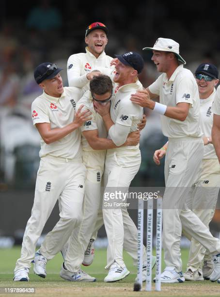 England bowler Joe Denly is congratulated by team mates left to right Sam Curran, Joe Root, Ben Stokes, and Stuart Broad, after taking the wicket of...
