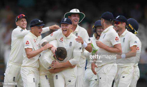 England bowler Joe Denly is congratulated by team mates left to right Joe Root, Sam Curran, Ben Stokes, Stuart Broad and James Anderson after taking...