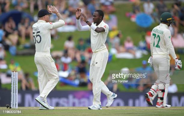 England bowler Jofra Archer and Ben Stokes celebrate after dismissing Rassie van der Dussen during Day Three of the First Test match between England...
