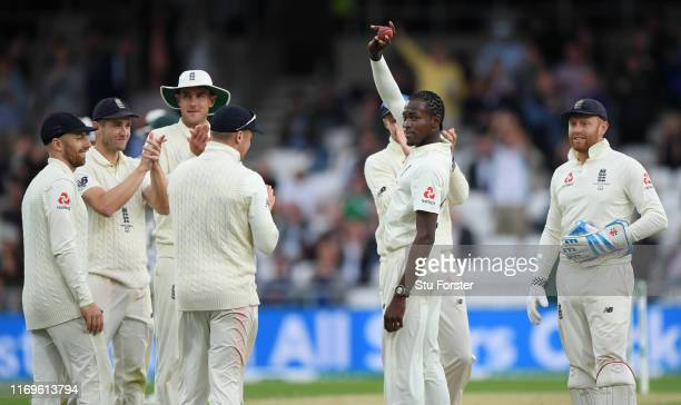 England bowler Jofra Archer celebrates by raising the ball after dismissing Pat Cummins to claim his first 5 wicket haul during day one of the 3rd...