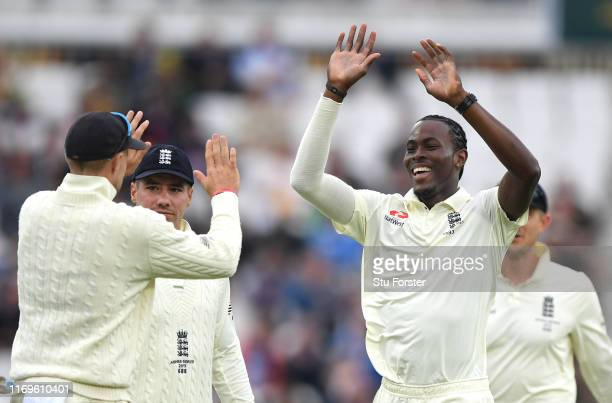 England bowler Jofra Archer celebrates with Joe Root after dismissing James Pattinson during day one of the 3rd Ashes Test match between England and...