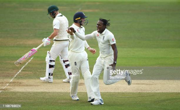 England bowler Jofra Archer celebrates with Jos Buttler after taking the wicket of David Warner during day five of the 2nd Ashes Test match between...