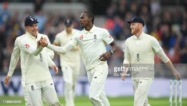 England bowler Jofra Archer celebrates with Rory Burns after taking the wicket of Australia opener Marcus Harris during day one of the 3rd Ashes Test...