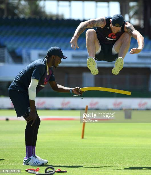 England bowler Jofra Archer holds the bar for Ben Stokes to jump over it during England nets ahead of the 3rd Test Match against South Africa at St...