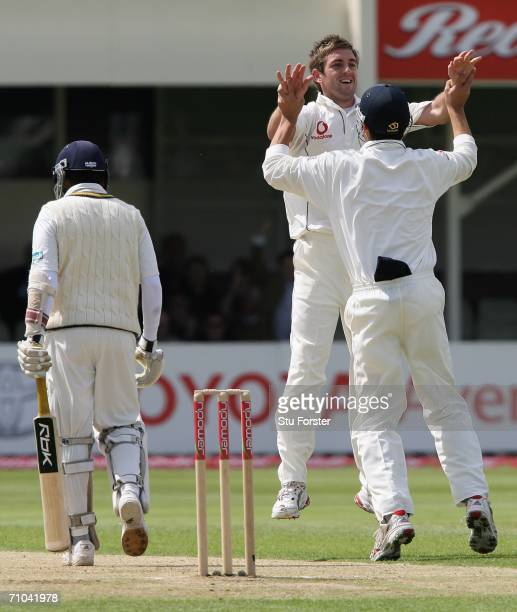 England bowler Liam Plunkett celebrates with Alastair Cook after dismissing Sri Lankan batsman Mahela Jayawardene for nought during the first day of...