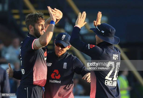 England bowler Liam Plunkett celebrates with teammates the wicket of South Africa batsman Faf Du Plessis during the first OneDay International...