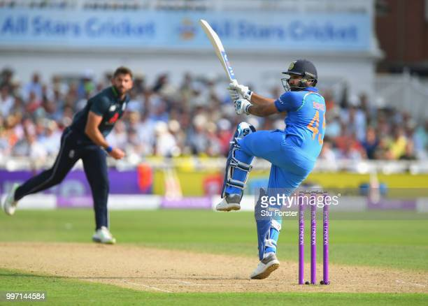 England bowler Liam Plunkett is pulled to the boundary by India batsman Rohit Sharma during the 1st Royal London One Day International match between...