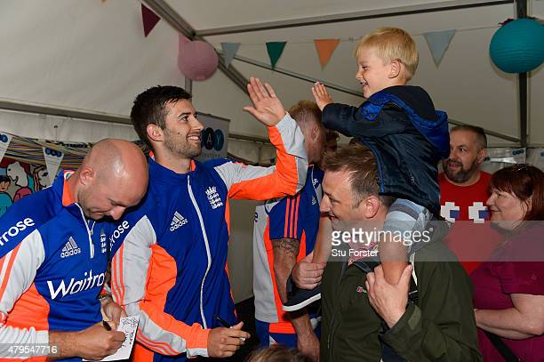 England bowler Mark Wood and Adam Lyth interact with fans during an autograph session at the Tafwyl 2015 event at Cardiff Castle on July 5 2015 in...