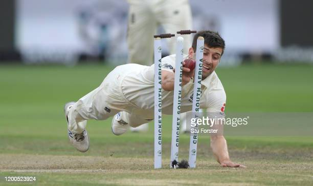 England bowler Mark Wood breaks the stumps but the South Africa batsman Keshav Maharaj just makes it home during Day Four of the Third Test between...