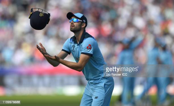 England bowler Mark Wood catches a helmet during the Group Stage match of the ICC Cricket World Cup 2019 between England and New Zealand at Emirates...