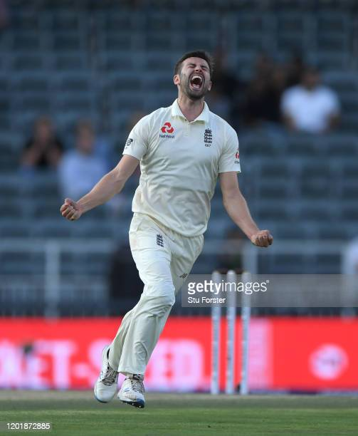 England bowler Mark Wood celebrates after dismissing Anrich Nortje during Day Two of the Fourth Test between South Africa and England at Wanderers on...