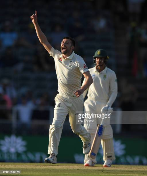 England bowler Mark Wood celebrates after dismissing Bavuma during Day Two of the Fourth Test between South Africa and England at Wanderers on...