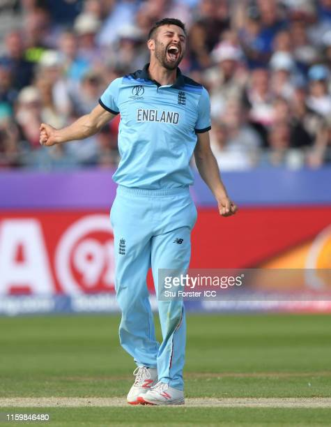 England bowler Mark Wood celebrates after dismissing Mitchell Santner during the Group Stage match of the ICC Cricket World Cup 2019 between England...