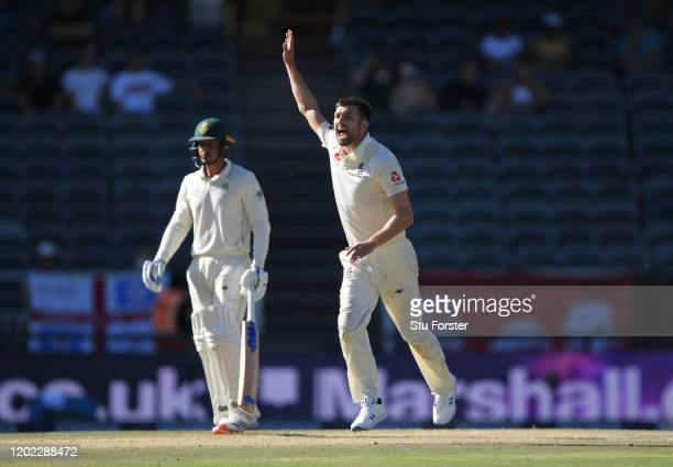 England bowler Mark Wood celebrates after dismissing Vernon Philander during Day Four of the Fourth Test between South Africa and England at...