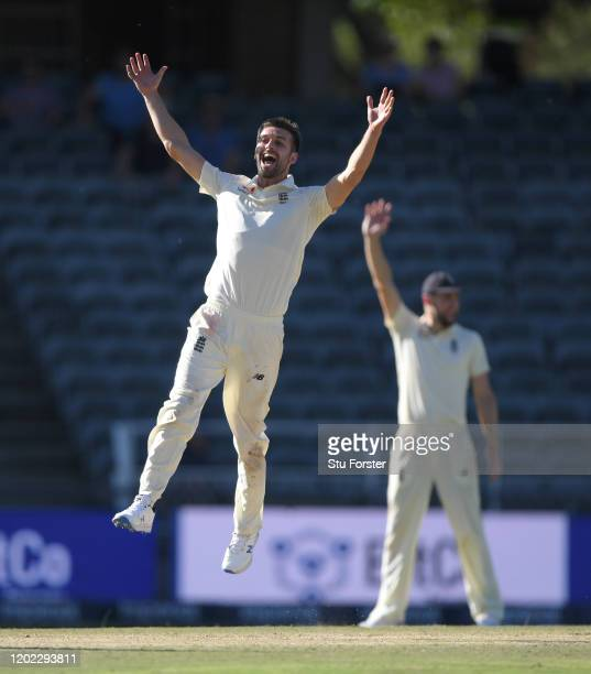 England bowler Mark Wood celebrates after taking the final South Africa wicket to win the match during Day Four of the Fourth Test between South...