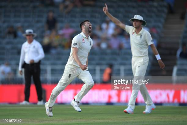 England bowler Mark Wood celebrates with Stuart Broad after dismissing Anrich Nortje during Day Two of the Fourth Test between South Africa and...