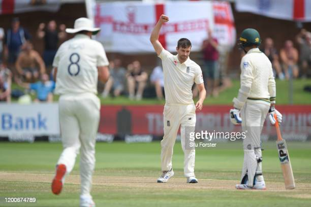 England bowler Mark Wood celebrtaes with team mates after Stuart Broad had caught Rabada during Day Five of the Third Test between South Africa and...