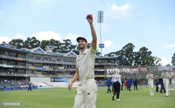 England bowler Mark Wood holds aloft the ball after taking 5 first innings wickets during Day Three of the Fourth Test between South Africa and...