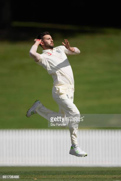 England bowler Mark Wood in action during day one of the Test warm up match between England and New Zealand Cricket XI at Seddon Park on March 12...