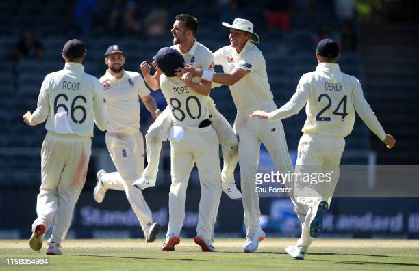 England bowler Mark Wood is congratulated by team mates after dismissing Rassie van der Dussen during Day Four of the Fourth Test between South...