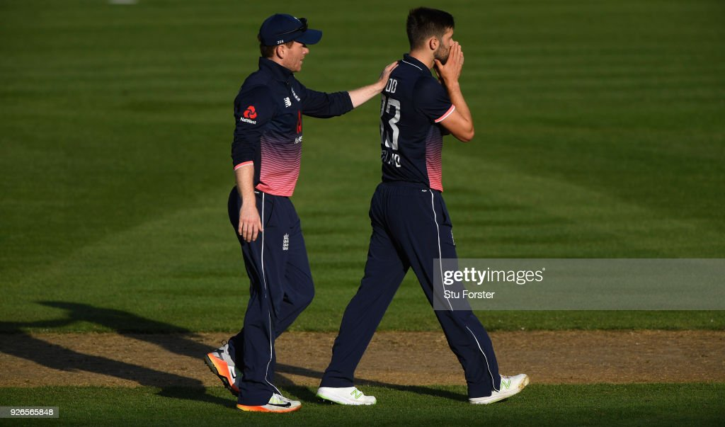 England bowler Mark Wood is consoled by captain Eoin Morgan after seeing a chance go begging during the 3rd ODI between New Zealand and England at Westpac stadium on March 3, 2018 in Wellington, New Zealand.