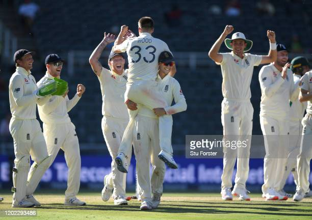 England bowler Mark Wood is lifted aloft by Joe Root after taking the final wicket of South Africa to win the match during Day Four of the Fourth...