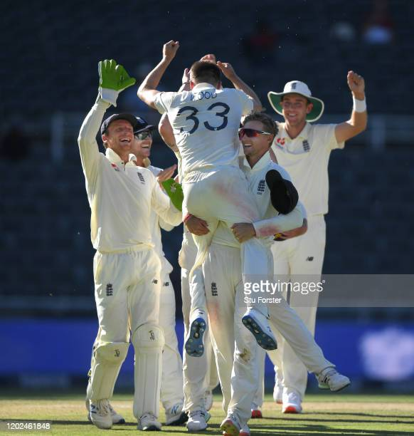 England bowler Mark Wood is lifted aloft by Joe Root after taking the final wicket of South Africa to win the match and the series 31 during Day Four...