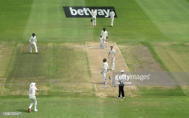 England bowler Mark Wood looks on as team mate Stuart Broad prepres to catch Kagiso Rabada during Day Five of the Third Test between South Africa and...