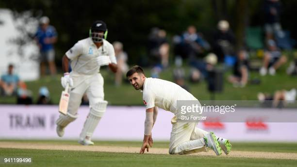 England bowler Mark Wood reacts as the New Zealand batsmen pick up runs during day five of the Second Test Match between the New Zealand Black Caps...