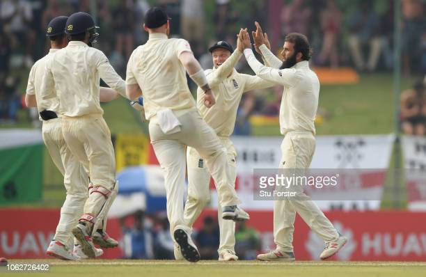 England bowler Moeen Ali and team mates celebrate after the bowler had taken the wicket of Angelo Matthews after a review during Day Four of the...