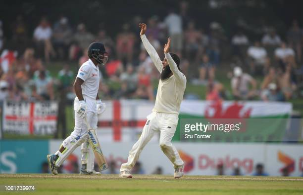 England bowler Moeen Ali appeals with success for the wicket of Sri Lanka batsman Dananjaya during Day Two of the Second Test match between Sri Lanka...