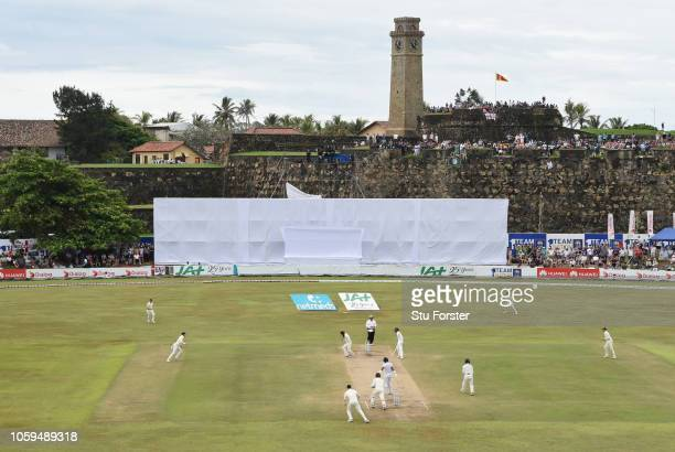 England bowler Moeen Ali catches Sri Lanka batsman Dimuth Karunaratne off his own bowling during Day Four of the First Test match between Sri Lanka...