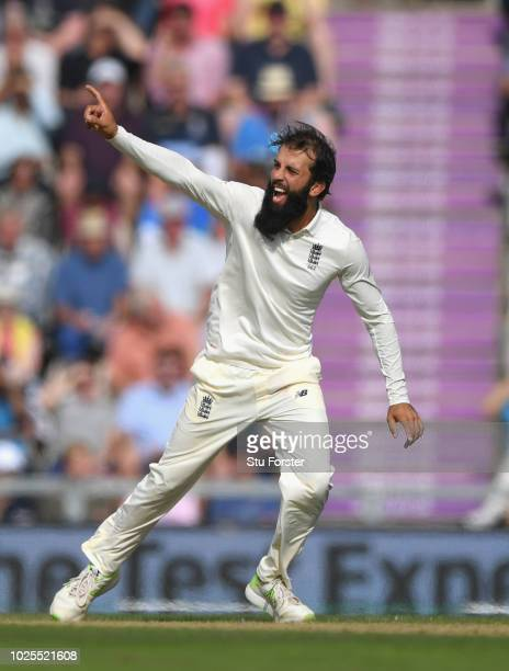England bowler Moeen Ali celebrates after bowling Ravi Ashwin during day two of the 4th Specsavers Test match between England and India at The Ageas...