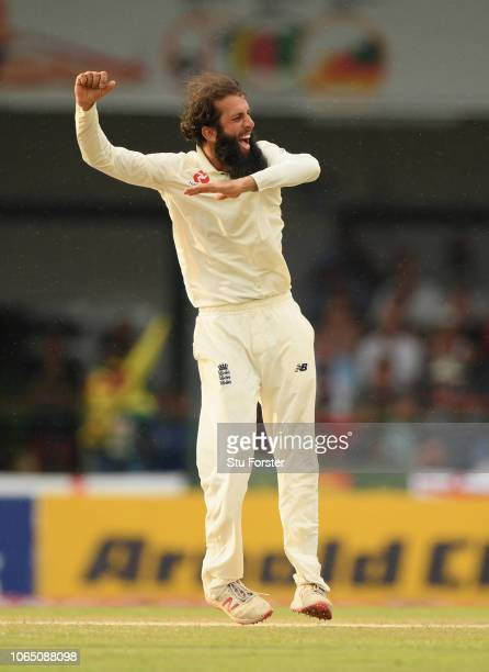 England bowler Moeen Ali celebrates after having had Sri Lanka batsman Dhanushka Gunathilleke caught for 6 runs during Day Three of the Third Test...
