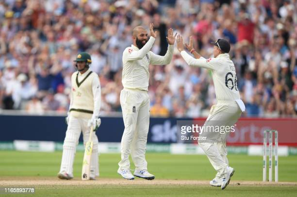 England bowler Moeen Ali celebrates after taking the wicket of Cameron Bancroft during Day three of the First Specsavers Test Match at Edgbaston on...