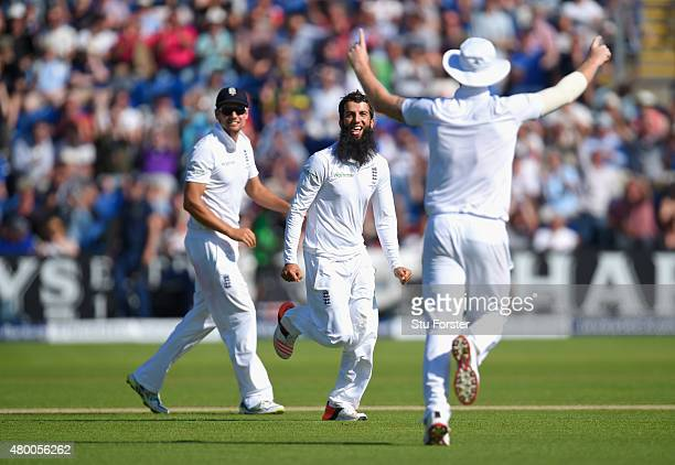 England bowler Moeen Ali celebrates with Alastair Cook and Ben Stokes after dismissing Michael Clarke during day two of the 1st Investec Ashes Test...