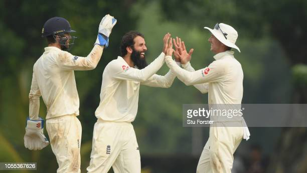 England bowler Moeen Ali celebrates with Joe Denley and Ben Foakes during day one of the two day warm up match between a Sri Lanka Board Presidents...