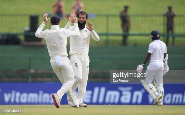 England bowler Moeen Ali celebrates with Jos Buttler after dismissing Sri Lanka batsman Dickwella during Day Five of the Second Test match between...