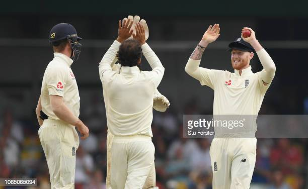 England bowler Moeen Ali celebrates with slip catcher Ben Stokes after he had caught Dhanushka Gunathilleke for 6 runs during Day Three of the Third...