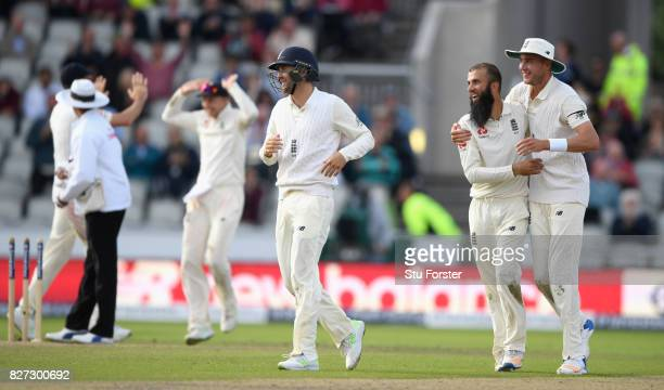 England bowler Moeen Ali is congratulated after taking the final South Africa wicket during day four of the 4th Investec Test match between England...