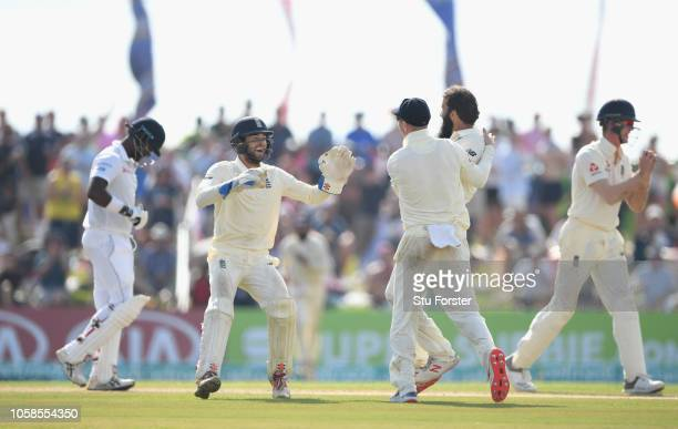 England bowler Moeen Ali is congratulated by Jack Leach and Ben Foakes after England fielder Keaton Jennings had caught out Sri Lanka batsman Angelo...