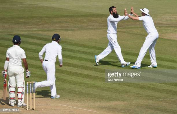 England bowler Moeen Ali is congratulated by Joe Root after taking the wicket of India batsman Cheteshwar Pujara during day four of the 3rd Investec...