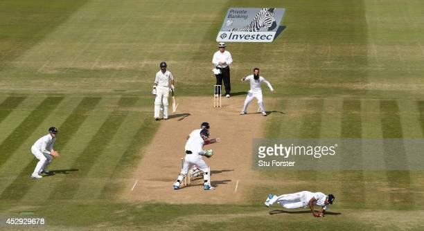 England bowler Moeen Ali takes the wicket of India batsman Cheteshwar Pujar who is caught by Chris Jordan during day four of the 3rd Investec Test...