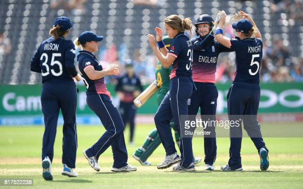 England bowler Natalie Sciver celebrates with team mates after wicketkeeper Sarah Taylor had stumped South Africa batsman Trisha Chetty hits out...