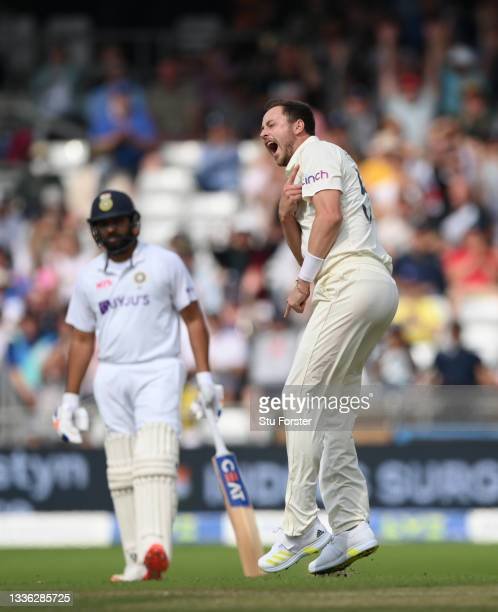 England bowler Ollie Robinson celebrates after taking the wicket of Rishabh Pant during day one of the Third Test Match between England and India at...