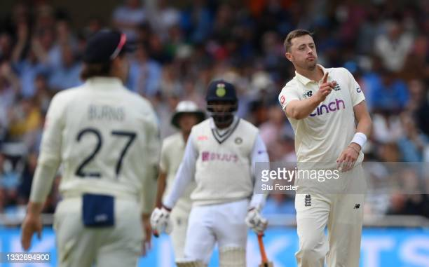 England bowler Ollie Robinson celebrates the wicket of India batsmen Shami during day three of the First Test Match between Enaches 50 runs gland and...