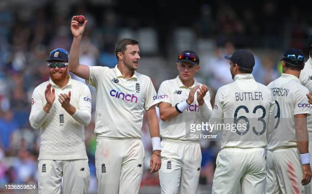 England bowler Ollie Robinson holds aloft the ball after taking his 5th wicket of the innings, Ishant Sharma during day four of the Third Test Match...