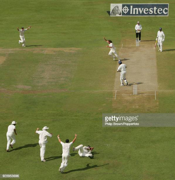 England bowler Ryan Sidebottom celebrates after getting the wicket of Sri Lanka's Kumar Sangakkara caught by Matt Prior for 1 run during the 2nd Test...