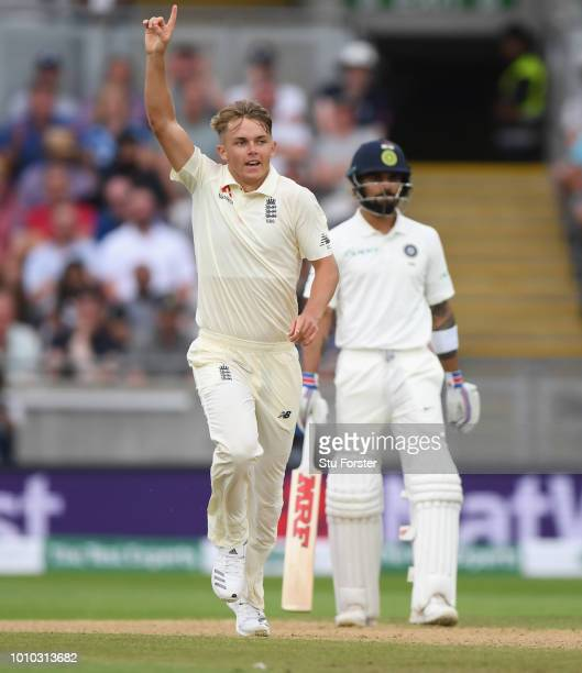 England bowler Sam Curran celebrates after taking the wicket of Ajinkya Rahane during day 3 of the First Specsavers Test Match at Edgbaston on August...