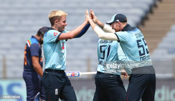 England bowler Sam Curran is congratulated by Ben Stokes after taking the wicket of India batsman Rohit Sharma during the 2nd One Day International...